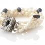 Усукана гривна от бели и черни, естествени перли 1