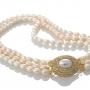 Стилно бижу от три наниза овални перли в прасковен и бял цвят 1