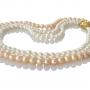 Нежно съчетание на естествени перли в бял и прасковен цвят 1