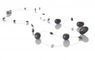 Нежно колие от продълговати, черни, естествени перли